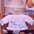 Белоснежный комплект для малыша на спицах
